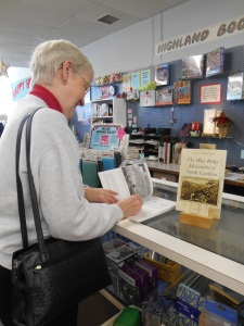 Janet, signing copies of her book at Highland Books in Brevard, NC.