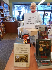 "Proud author with her book on the ""Autographed"" table at Blue Ridge Books."