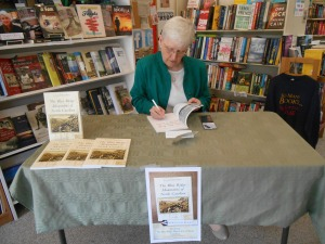 Janet, autographing a copy of her book at The Book Shelf.