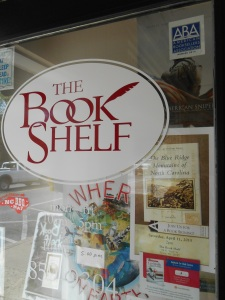Front door of The Book Shelf with a poster promoting my book signing.